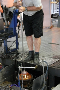 Glass blowing into the mold.